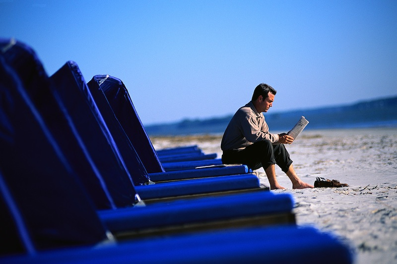 Man Reading Newspaper at Beach - Microsoft Office Clipart