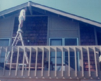 17. 1970s - dad up a ladder on balcony above garage.