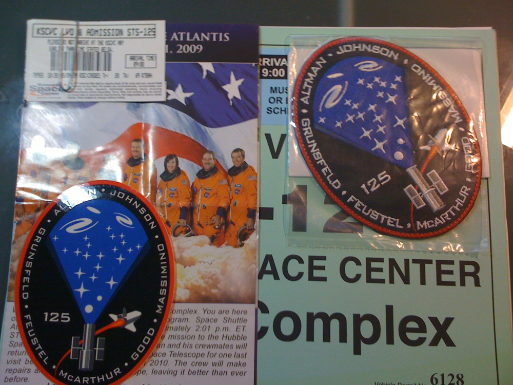 STS-125 mission decal, patch, ticket, parking card and handout